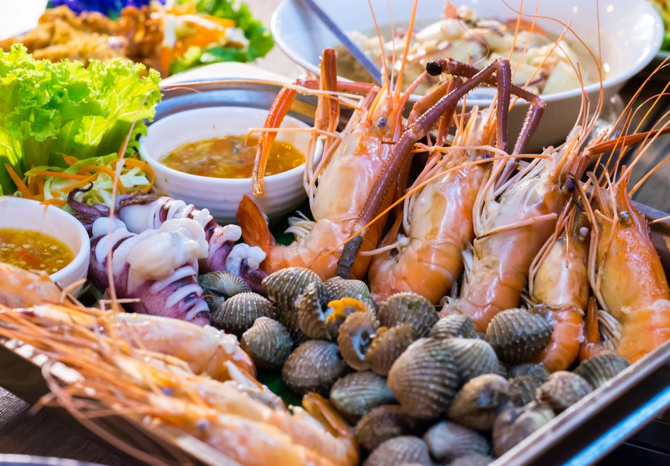 Tray of prawns, squids and clams with spicy and sour dipping sauce that is packed full of Thai seafood flavour